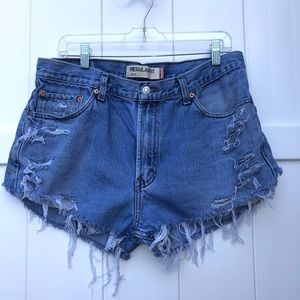 Vintage Levi's cut off high rise distressed shorts